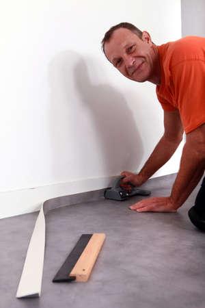 laying grey carpet photo