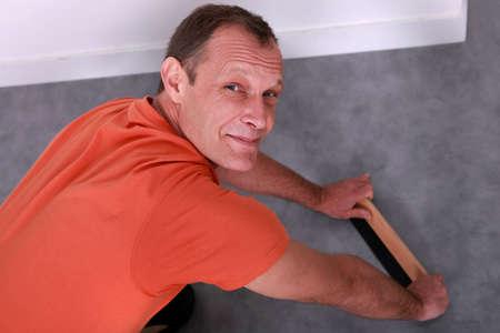 knees bent: Artisan with carpet