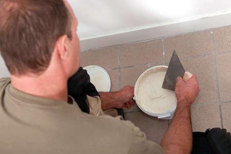 caulk: Male plasterer
