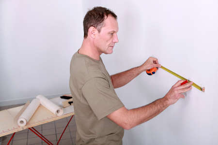 Man measuring wall Stock Photo - 13811491