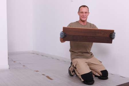 median age: Man laying parquet floor
