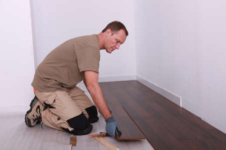 Man installing parquet flooring photo