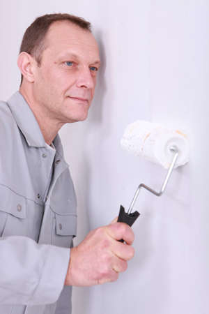 craftsman painting a wall photo