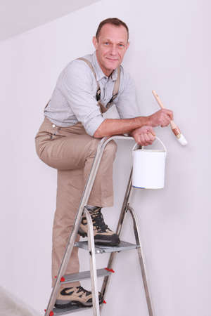 Man posing with paint brush whilst up ladder Stock Photo - 13810813