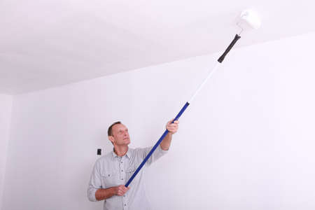 Man painting ceiling Stock Photo - 13808585