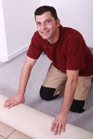 Horizontal image of a man laying carpet photo