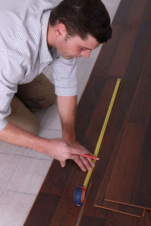 Man measuring flooring photo