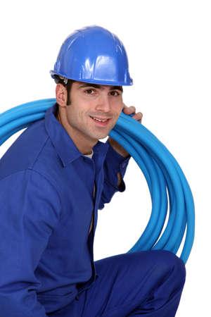 hunker: portrait of handsome plumber Stock Photo