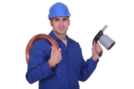 Plumber with a blowtorch photo