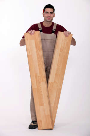 Man stood with wooden flooring photo