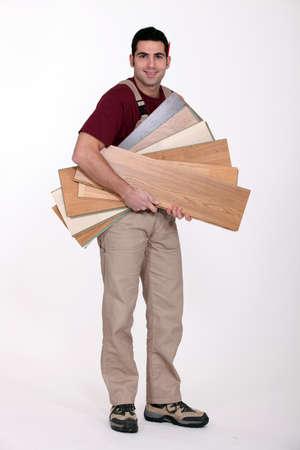 fluency: Man with parquet slats Stock Photo