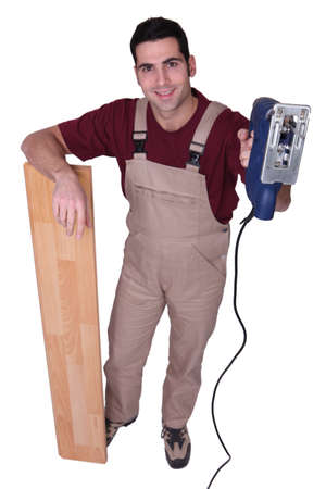 lean machine: joiner with parquet strips and sander machine Stock Photo