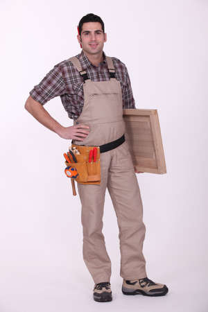Carpenter with wooden door photo