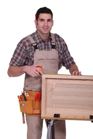 closet door: A carpenter working on a closet door.