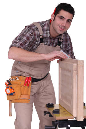 closet door: A carpenter fixing a closet door.