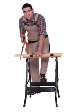 workmate: Carpenter cutting wood Stock Photo