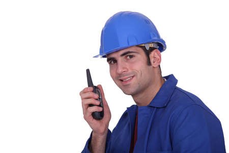 Construction worker with a two-way radio photo
