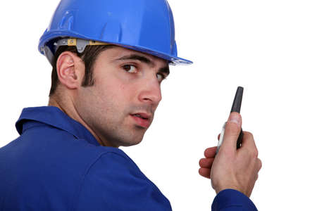 Builder using a walky talky photo