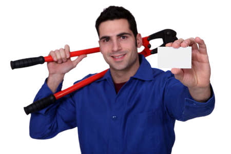 worker with giant spanner holding business card photo