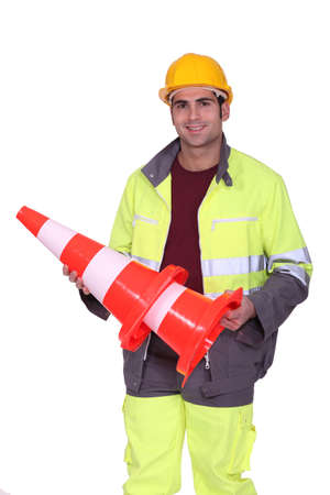 road worker: Highway worker with traffic cones Stock Photo