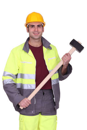 Traffic guard holding a mallet photo