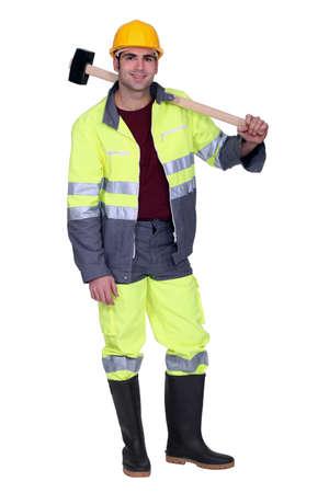sledgehammer: Construction worker with a sledgehammer