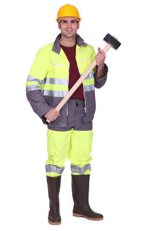 high visibility: Workman with a sledgehammer