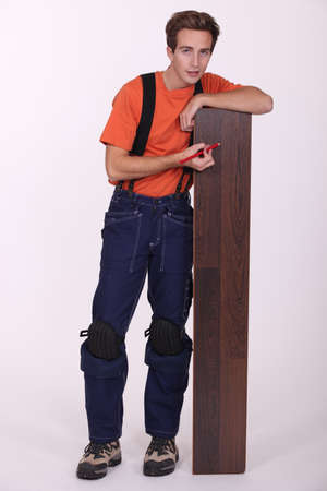Young man with wood flooring photo
