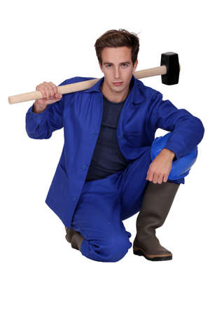Worker with a sledgehammer photo