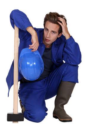 sledge hammer: Tired construction worker