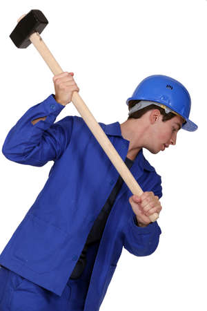 scuff: Man holding sledgehammer