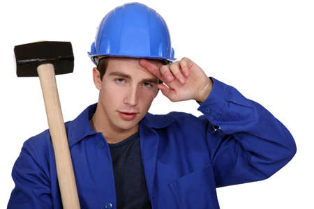 Worker with a mallet photo