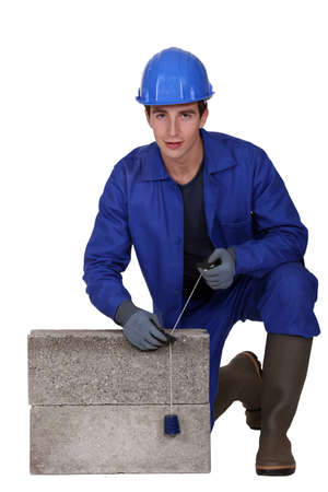 Bricklayer in blue overalls Stock Photo - 13809600