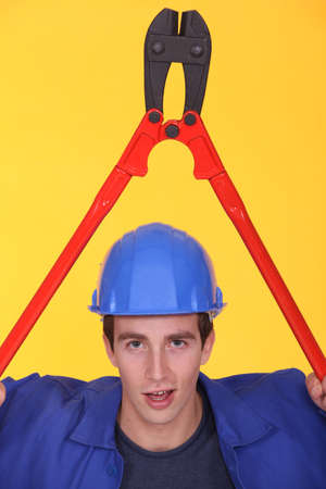 Man holding bolt-cutter over his head Stock Photo - 13808096