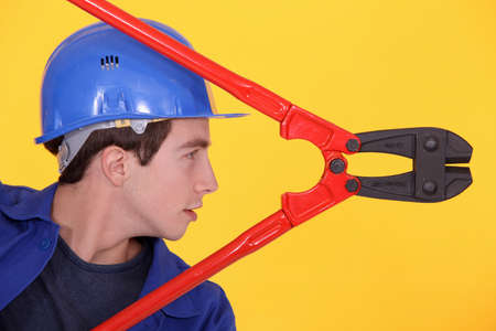 Young man with boltcutters Stock Photo - 13809170