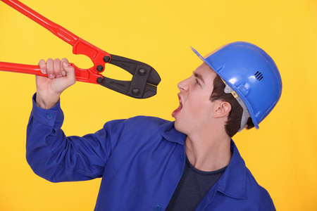 Man holding bolt cutters Stock Photo - 13810258