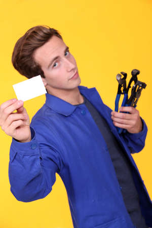 puttering: Handyman showing his business card