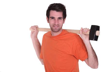 sledge hammer: Man with a sledge hammer