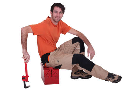 Man sitting on toolbox photo
