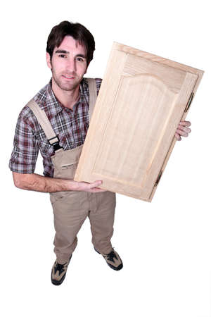 wood carving door: A craftsman holding up his work Stock Photo