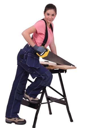 Woman sawing plank of wood Stock Photo - 13805073