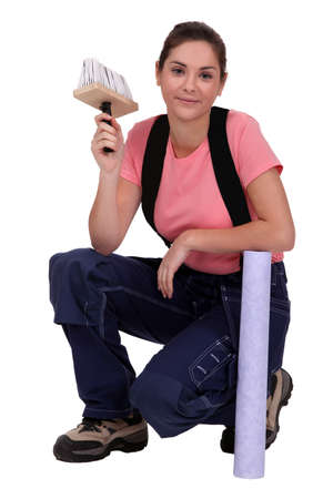Portrait of a woman about to wallpaper a house photo