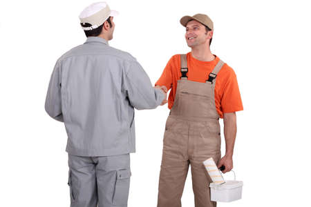 tradespeople: Painters shaking hands Stock Photo