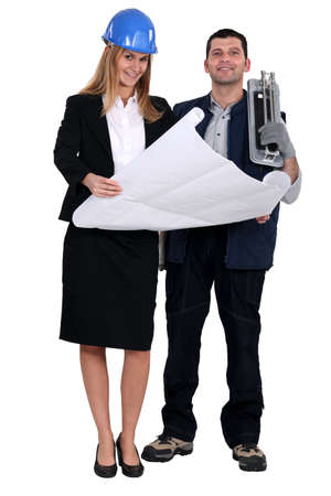 tile cutter: Tile cutter stood with female architect Stock Photo