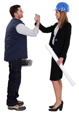 Architect shaking hands with a tiler Stock Photo - 13805492