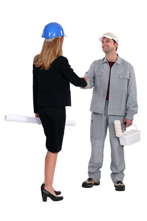 businesswoman and craftsman shaking hands photo