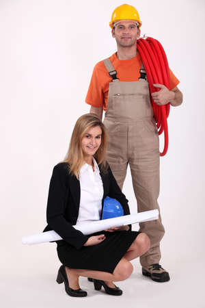 businesswoman and craftsman posing together Stock Photo - 13809332