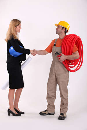 Business professional shaking a tradesman's hand photo