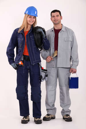 servicewoman: female electrician with male painter