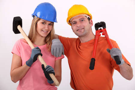 equal: Man and woman with hammer